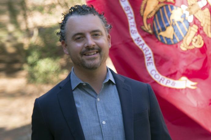 Ryan Sawyer with marine corp flag